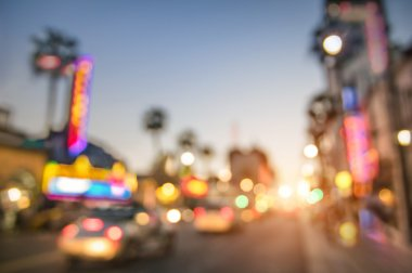 Defocused blur of Hollywood Boulevard at sunset - Bokeh abstract view of world famous Walk of Fame in California - United staes of America wonders - Emotional saturated filter with powered sunshine stock vector