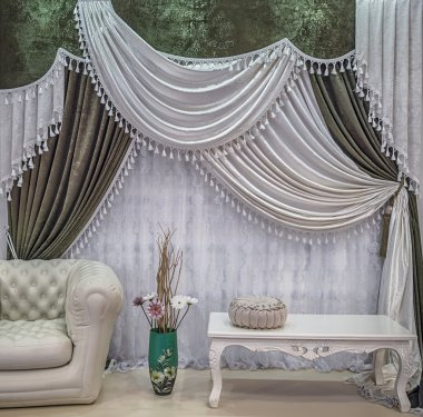 An interior design in the green and white colors. Contrasting curtains with the pelmet and light translucent tulle.