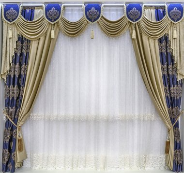 The luxurious design of the windows and walls. Draperies, pelmet and a tulle. The combination of gold-tone curtains and the blue cloth with ornaments.