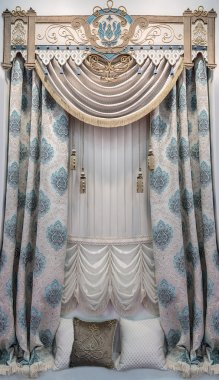 A window and a wall in the palace style. The combination of French curtains with drapes. Soft and Hard pelmet with the applique.