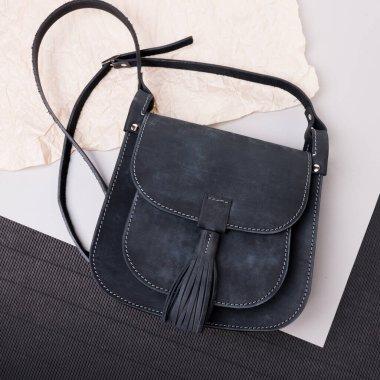 Leather black bag. Grunge texture. Black, grey beige background. crumpled paper