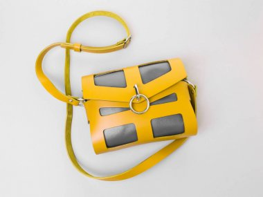 Crossbody bag yellow and grey leather. Model for woman