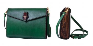 Green women's bag made of genuine leather and walnut and ash wood. Metal fittings made of brass. The clutch bag closes with a flap on the brown leather clasp