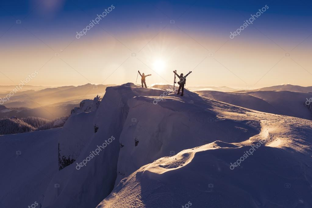 happy people on top of the mountain