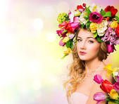 Fotografie Spring woman portrait hairstyle with flowers