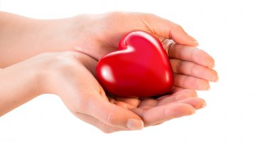 Woman hands giving heart - love and sharing concept