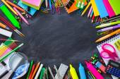 Fotografie School stationery on blackboard framing - back to School