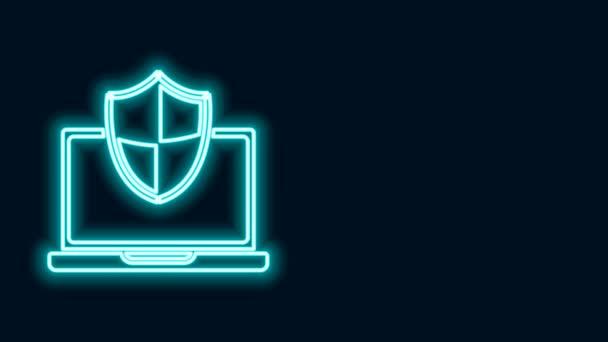Világító neon vonal Laptop védett pajzs ikon elszigetelt fekete alapon. PC biztonság, tűzfal technológia, adatvédelem. 4K Videó mozgás grafikus animáció
