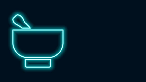 Glowing neon line Magic mortar and pestle icon isolated on black background. 4K Video motion graphic animation