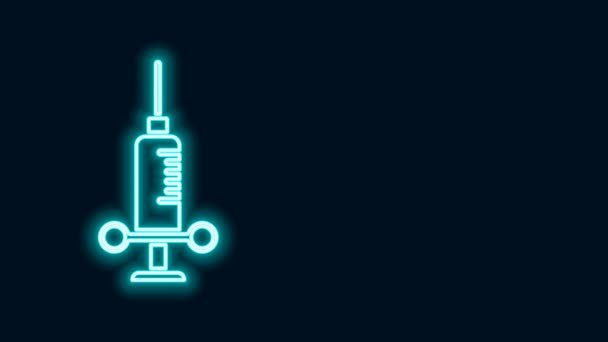 Glowing neon line Dental medical syringe with needle icon isolated on black background. 4K Video motion graphic animation