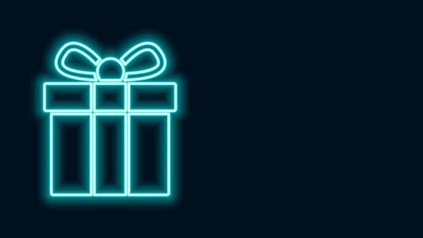 Leuchtende Neon-Linie Gift Box-Symbol isoliert auf schwarzem Hintergrund. 4K Video Motion Grafik Animation