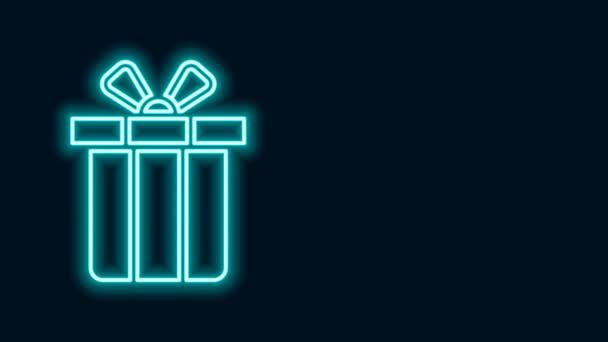 Zářící neonová čára Ikona dárkové krabice izolované na černém pozadí. Veselé Vánoce a šťastný nový rok. Grafická animace pohybu videa 4K