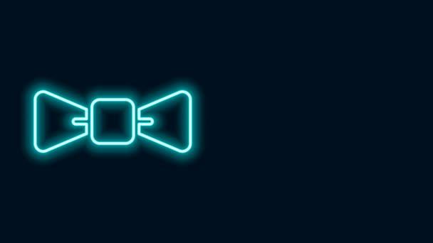 Ragyogó neon vonal Íj nyakkendő ikon elszigetelt fekete háttér. 4K Videó mozgás grafikus animáció