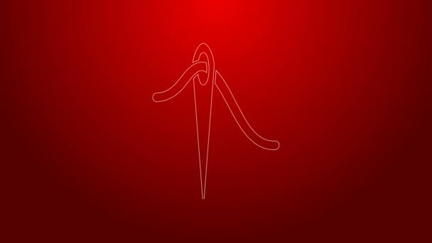 Grüne Stricknadel zum Nähen mit Fadensymbol auf rotem Hintergrund. Maßanfertigung. Textil nähen Handwerk Zeichen. Stickwerkzeug. 4K Video Motion Grafik Animation
