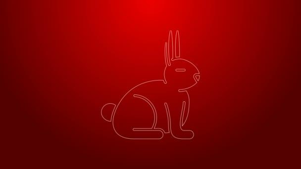 Grüne Linie Kaninchen-Symbol isoliert auf rotem Hintergrund. 4K Video Motion Grafik Animation