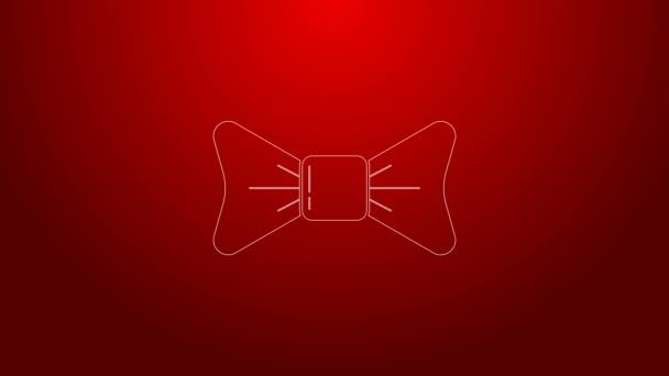 Zöld vonal Íj nyakkendő ikon elszigetelt piros háttérrel. 4K Videó mozgás grafikus animáció