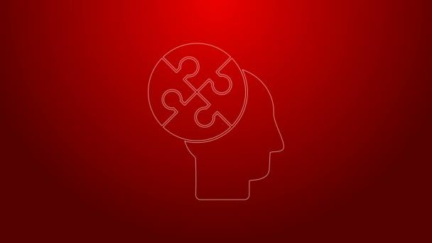 Zöld vonal Az emberi fej rejtvények stratégia ikon elszigetelt piros háttér. Gondolkodó agyjel. Az agy jelképe. 4K Videó mozgás grafikus animáció