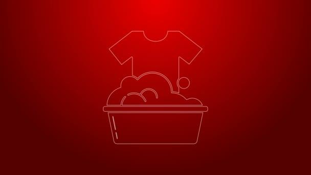 Grüne Linie Plastikbecken mit Seifenlauge Symbol isoliert auf rotem Hintergrund. Schüssel mit Wasser vorhanden. Wäsche waschen, Ausrüstung reinigen. 4K Video Motion Grafik Animation