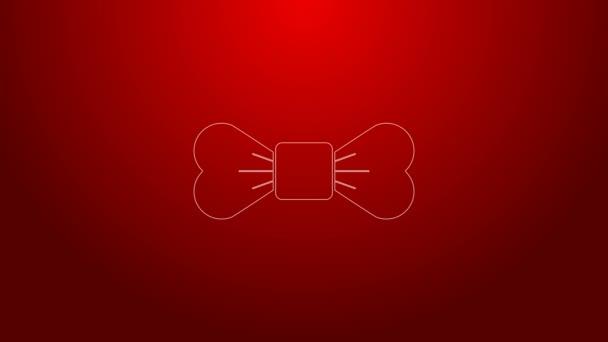 Zelená čára Bow tie ikona izolované na červeném pozadí. Grafická animace pohybu videa 4K