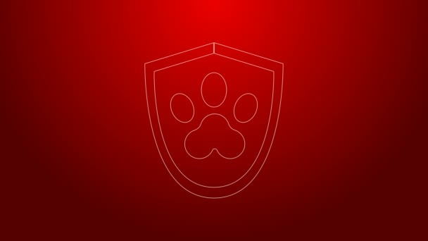 Zelená čára Ikona veterinárního pojištění izolované na červeném pozadí. Ikona ochrany zvířat. Otisk psí nebo kočičí tlapky. Grafická animace pohybu videa 4K