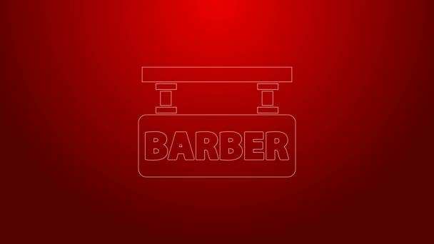 Zöld vonal Barbershop ikon elszigetelt piros háttérrel. Fodrászlogó vagy cégtábla. 4K Videó mozgás grafikus animáció