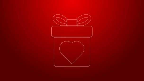 Zöld vonal Ajándék doboz szív ikon elszigetelt piros háttér. Valentin nap. 4K Videó mozgás grafikus animáció