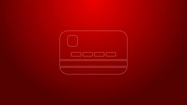 Zöld vonal Hitelkártya ikon elszigetelt piros háttér. Online fizetés. Készpénzfelvétel. Pénzügyi műveletek. Bevásárlótábla. 4K Videó mozgás grafikus animáció