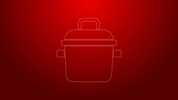 Zelená čára Ikona hrnce vaření izolované na červeném pozadí. Vařit nebo dušené jídlo symbol. Grafická animace pohybu videa 4K