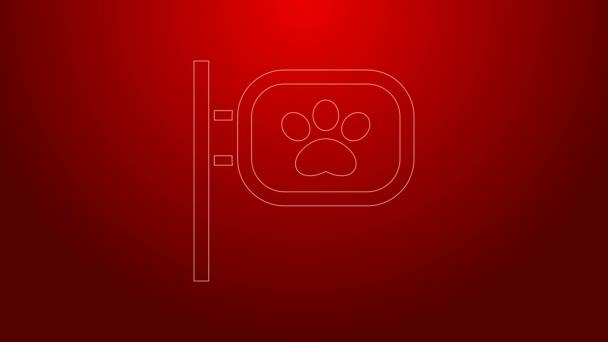 Zöld vonal Kisállat ápolás ikon elszigetelt piros háttér. Kisállat fodrászat. Fodrászat kutyáknak és macskáknak. 4K Videó mozgás grafikus animáció