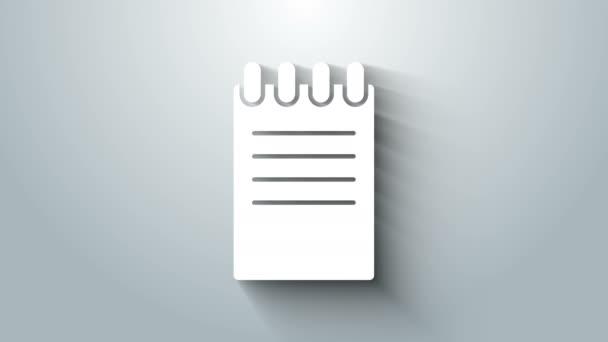 Fehér Notebook ikon elszigetelt szürke háttérrel. Spirál jegyzettömb ikon. Iskolai füzet. Írócédula. Üzleti napló. Szerelmünk laptopja. 4K Videó mozgás grafikus animáció