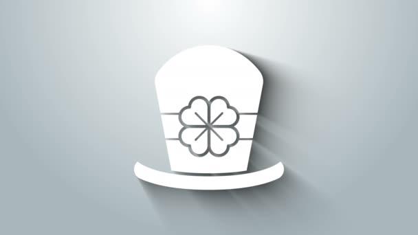 Bílý Leprechaun klobouk a čtyři listy jetele ikony izolované na šedém pozadí. Šťastný den svatého Patricka. Grafická animace pohybu videa 4K