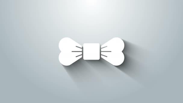 Fehér csokornyakkendő ikon elszigetelt szürke háttér. 4K Videó mozgás grafikus animáció