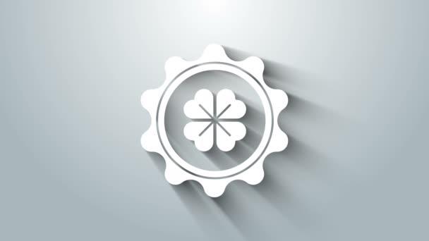 Bílé víčko lahvičky se čtyřmi listy jetele ikony izolované na šedém pozadí. Šťastný den svatého Patricka. Grafická animace pohybu videa 4K