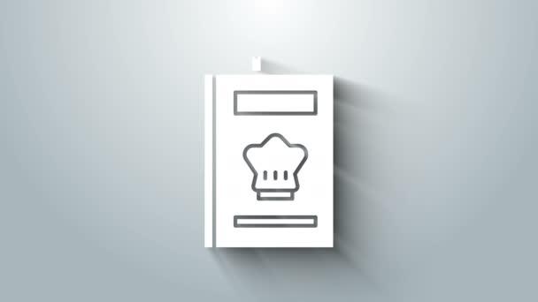 Bílá ikona kuchařky izolovaná na šedém pozadí. Ikona kuchařky. Recept. Ikony vidličky a nože. Symbol příboru. Grafická animace pohybu videa 4K