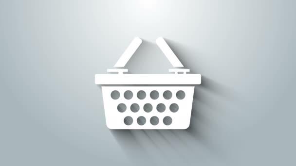Bílý Nákupní košík ikona izolované na šedém pozadí. Online nákupní koncept. Podpis doručovací služby. Symbol nákupního košíku. Grafická animace pohybu videa 4K