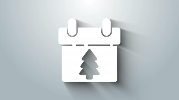 Fehér naptár ikon elszigetelt szürke háttér. Eseményemlékeztető szimbólum. Boldog karácsonyt és boldog új évet! 4K Videó mozgás grafikus animáció