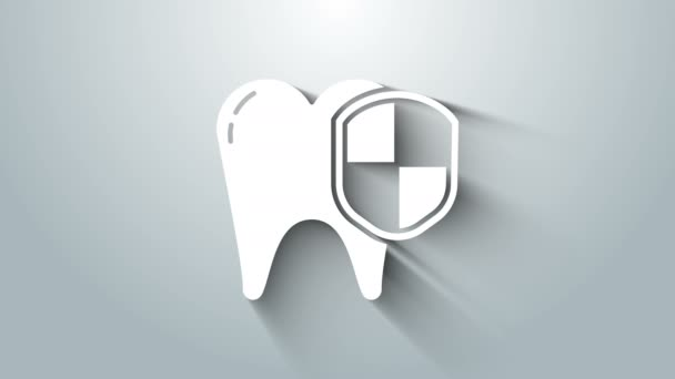 White Dental protection icon isolated on grey background. Tooth on shield logo. 4K Video motion graphic animation