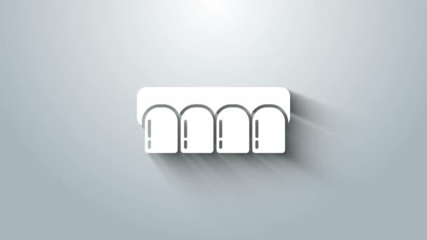 Weißes Prothesenmodell isoliert auf grauem Hintergrund. Zähne des Oberkiefers. Zahnkonzept. 4K Video Motion Grafik Animation