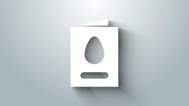 Fehér üdvözlőlap Boldog Húsvét ikonnal, szürke alapon elszigetelve. Ünnepi plakát sablon meghívó vagy üdvözlőlap. 4K Videó mozgás grafikus animáció