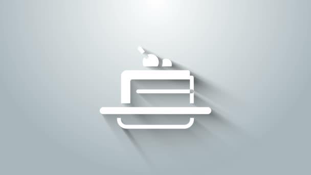 Fehér torta ikon elszigetelt szürke háttérrel. Boldog szülinapot! 4K Videó mozgás grafikus animáció