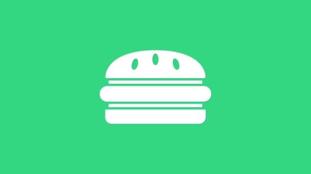 Fehér Burger ikon elszigetelt zöld alapon. Hamburger ikon. Sajtburger szendvics tábla. Gyorsétlap. 4K Videó mozgás grafikus animáció
