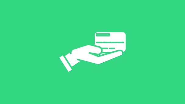 Weiße Menschenhand mit Kreditkartensymbol isoliert auf grünem Hintergrund. Online-Zahlung. Bezahlen Sie mit Karte. Finanzgeschäfte. 4K Video Motion Grafik Animation