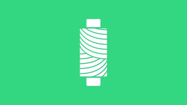 White Sewing thread on spool icon isolated on green background. Yarn spool. Thread bobbin. 4K Video motion graphic animation