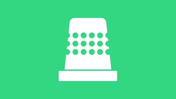 White Thimble for sewing icon isolated on green background. 4K Video motion graphic animation