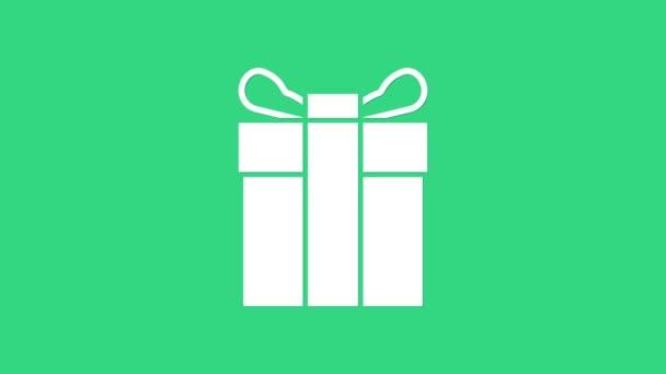 Ikona bílé dárkové krabice izolované na zeleném pozadí. Grafická animace pohybu videa 4K