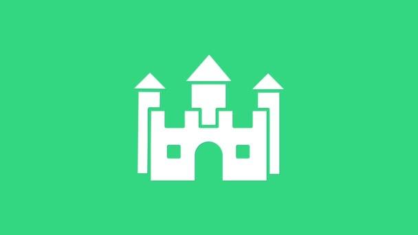 Fehér kastély ikon elszigetelt zöld háttérrel. 4K Videó mozgás grafikus animáció