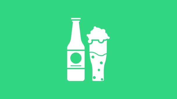 White Beer bottle and glass icon isolated on green background. Alcohol Drink symbol. 4K Video motion graphic animation
