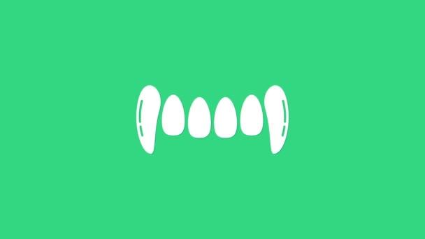 Weiße Vampirzähne isoliert auf grünem Hintergrund. Frohe Halloween-Party. 4K Video Motion Grafik Animation