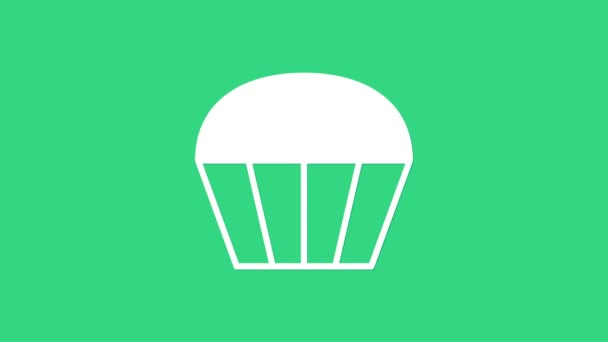 White Muffin icon isolated on green background. 4K Video motion graphic animation