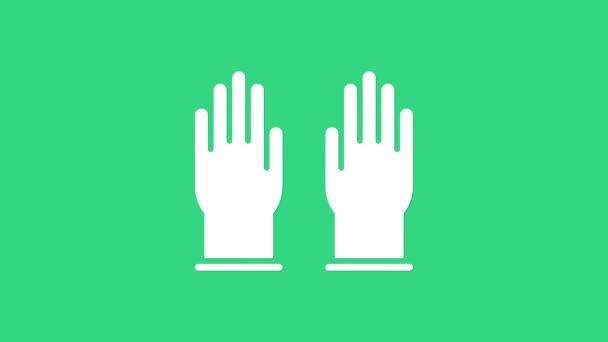 Bílé gumové rukavice ikona izolované na zeleném pozadí. Ochranné latexové označení. Symbol zařízení pro úklid domácnosti. Grafická animace pohybu videa 4K